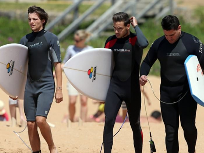 Shirtless Liam Payne and Louis Tomlinson in Wetsuits